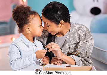 Stunning mom and daughter sharing a family moment