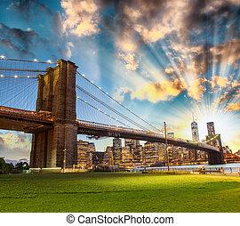 Stunning night skyline of Manhattan from Brooklyn Bridge...