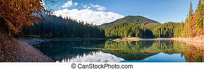 stunning panorama of mountain lake in autumn. Beautiful ...