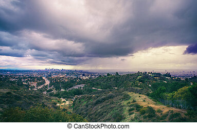 Stunning Panoramic aerial view of Los Angeles in a rainy stormy weather overlooking Downtown, Hollywood and other areas.