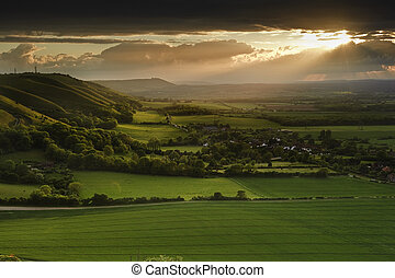 Landscape over English countryside landscape in Summer sunset