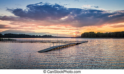 Stunning sunset at the lake with dynamic sky, Poland