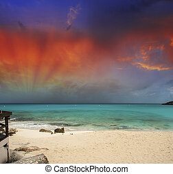Stunning sunset over a pristine caribbean beach