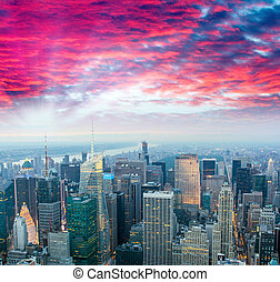 Stunning sunset over Midtown Manhattan, aerial view of New York