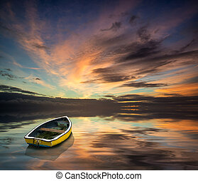 Stunning vibrant blue and pink Winter sky with single boat floating on ocean