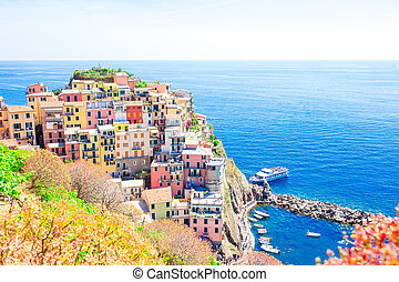 Stunning view of the beautiful and cozy village of Manarola from above in Cinque Terre reserve. Liguria region of Italy.