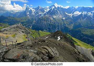 Stunning view of the famous peaks: Eiger, Monch and Jungfrau of Swiss Alps on Bernese Oberland, form top of Schilthorn, Canton of Bern, Switzerland.