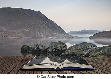 Stunning Winter foggy sunrise on Crummock Water in Lake District England concept coming out of pages in open book