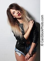Stunning woman posing in a studio.