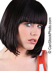 Stunning woman with a bobbed hairstyle