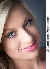 Stunning Young Blond Female green eyes, smiling