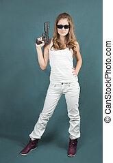 young woman posing with a handgun