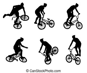 stunt bicyclists silhouettes