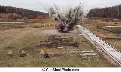 Stunt girl in a fiery explosion. Slow motion.