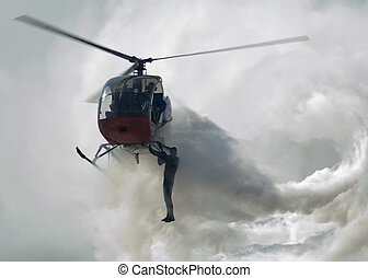 Stunt Man Hanging from Helicopter