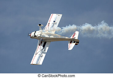 stunt plane against blue sky