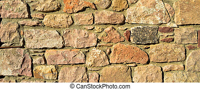 Sturdy beige and purple cut stone wall, seamless lined up