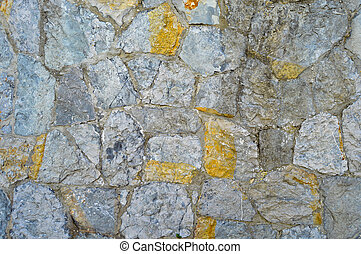 Sturdy blue and gray cut stone wall, seamless lined up