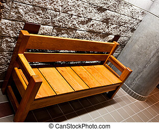 Sturdy wooden bench with arms
