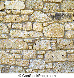 Sturdy yellow and beige cut stone wall, seamless lined up