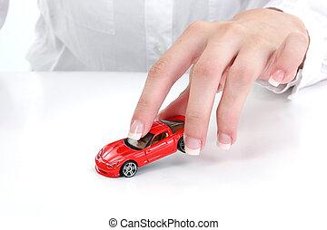 stykke legetøj, rød vogn, hånd