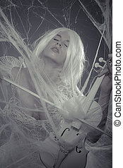Style beautiful woman trapped in a spider web with a white violin, lace dress