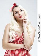Style Concept. Young Caucasian Blond Female Posing in Pinup Style Against White Background