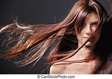 Style hair - A pretty young girl with flying hair