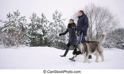 Style young couple having fun in winter park near lake with...