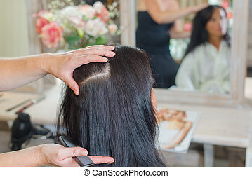 Styling a woman's hair in the salon