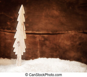Stylised wooden Christmas tree in snow
