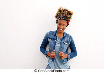 Stylish african woman smiling against white background