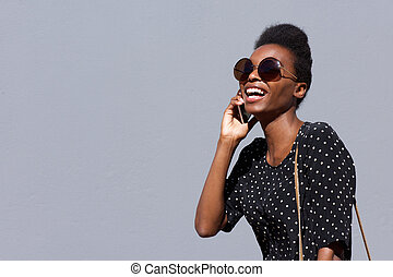 Stylish african woman talking on cellphone