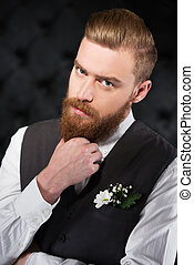 Stylish and bizzare man with beard