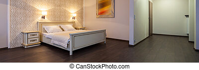 Stylish and elegant bedroom in hotel room, panorama