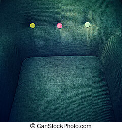 Stylish armchair with colorful decorative buttons