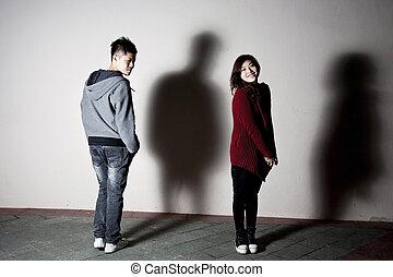 Stylish asian couple on street