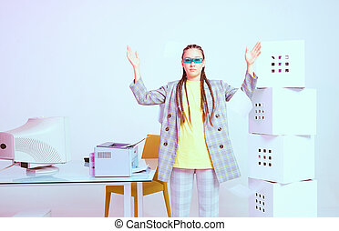 Stylish asian female office worker with obsolete computer in strange pose. Colored Neon light
