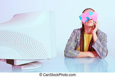 Stylish asian female office worker with stickers on her face sitting near obsolete computer