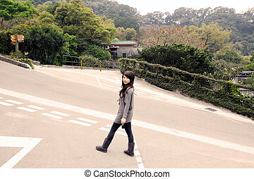 Stylish asian woman in a park