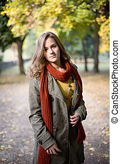 Stylish autumn fashion girl in the park.
