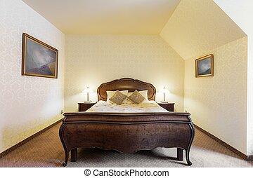 Stylish bed in luxury bedroom