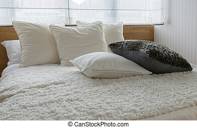 stylish bedroom interior design with black and white pillows on bed.