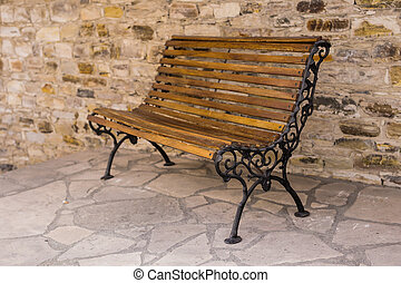 Stylish bench In the old stone town.