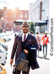 stylish black guy in hat looking at the camera
