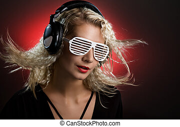 Stylish blond woman with shutter glasses and headphones