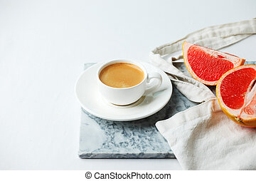 Stylish breakfast concept - cup of coffee, red grapefruit, ...