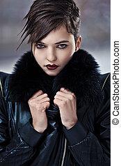 Stylish brunette woman in leather coat