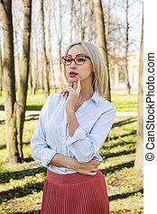 Stylish business woman, outdoors fashion portrait