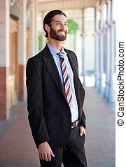 Stylish businessman smiling in suit